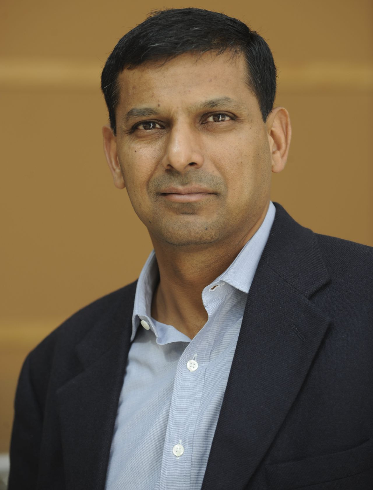 """Economist Raghuram G. Rajan poses at an undisclosed location on Sept. 1, 2009. """"Fault Lines: How Hidden Fractures Still Threaten the World Economy"""" is the latest book by Rajan. Source: Princeton University Press via Bloomberg EDITOR'S NOTE: NO SALES. EDITORIAL USE WITH PREVIEW/REVIEW OF BOOK ONLY."""