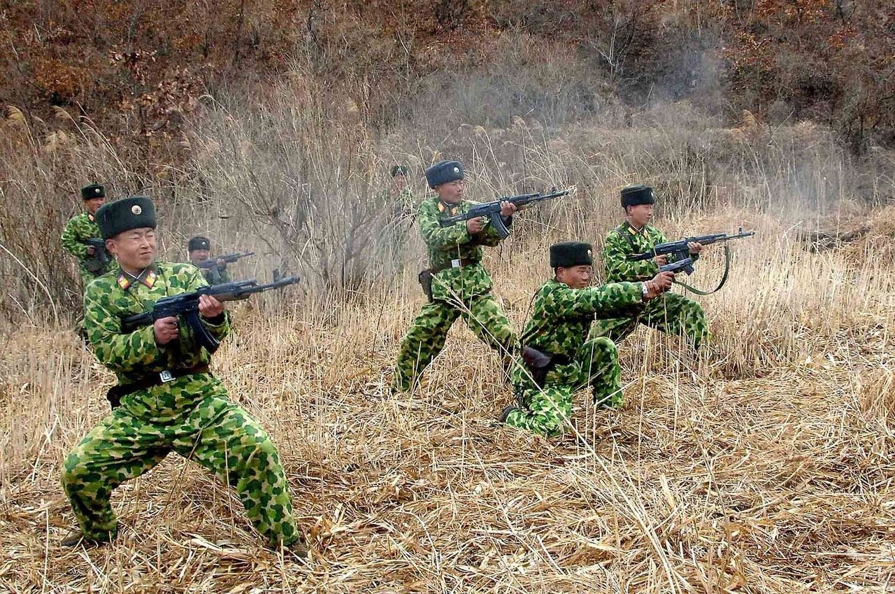 "TOPSHOTS This undated photo released by North Korea's official Korean Central News Agency (KCNA) via the Korean News Service (KNS) on March 11, 2013 shows Korean People's Army soldiers holding a military drill in an undisclosed location. North Korea leader Kim Jong-Un threatened to ""wipe out"" a South Korean island as Pyongyang came under new economic and diplomatic fire from US sanctions and UN charges of gross rights abuses. AFP PHOTO / KCNA / KNS ---EDITORS NOTE--- RESTRICTED TO EDITORIAL USE - MANDATORY CREDIT ""AFP PHOTO / KCNA VIA KNS"" - NO MARKETING NO ADVERTISING CAMPAIGNS - DISTRIBUTED AS A SERVICE TO CLIENTS"