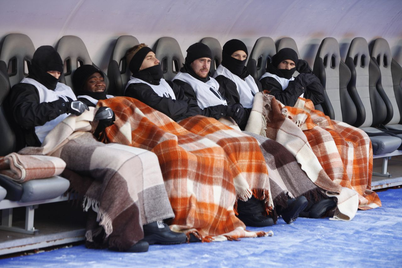 FC Twente's reserve teammates warm themselves with woolen blankets at the side of the pitch, before their UEFA Europa League match against Rubin Kazan's team at Luzhniki stadium in frozen Moscow, Russia, Thursday, Feb. 17, 2011. A cold wave hit Moscow with temperatures of -18 C (-0.4F) dropping to -23 C (-9.4F) overnight.(AP Photo/Alexander Zemlianichenko)