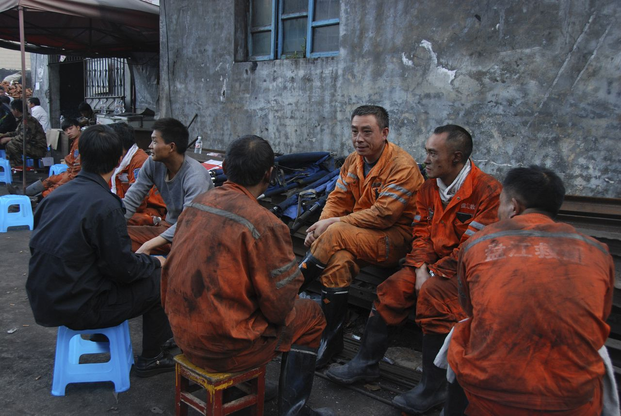 27 Nov 2014, China --- (141127) -- LIUPANSHUI, Nov. 27, 2014 (Xinhua) -- Rescuers rest at the accident site in Songlin coal mine in Songhe Town of Panxian County, southwest China's Guizhou Province, Nov. 27, 2014. A total of 11 people were killed in an explosion happened in the coal mine in Guizhou Province Thursday morning, local authorities said. (Xinhua/Liu Jiayue) (yxb) --- Image by © Liu Jiayue/Xinhua Press/Corbis