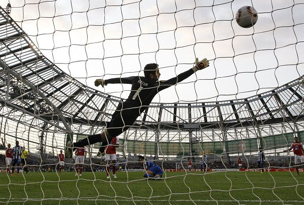 Radamel Falcao, from Colombia, bottom center, scores the opening goal past goalkeeper Artur Moraes, from Brazil during the UEFA Europa League final soccer match between Portugal's FC Porto and SC Braga at the Dublin Arena in Dublin, Ireland Wednesday May 18 2011. (AP Photo/Matt Dunham)
