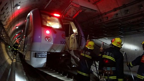 Caption: Firemen work to evacuate injured people in the underground tunnel of Line 10 after a train collision in Shanghai September 27, 2011. Two subway trains collided in Shanghai on Tuesday, leaving around 40 passengers injured, official media reported. REUTERS/China Daily (CHINA - Tags: DISASTER TRANSPORT TPX IMAGES OF THE DAY) CHINA OUT. NO COMMERCIAL OR EDITORIAL SALES IN CHINA