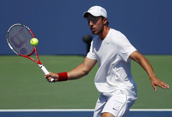 Igor Sijsling of the Netherlands hits a return to David Ferrer of Spain during their men's singles match at the U.S. Open tennis tournament in New York August 31, 2012.