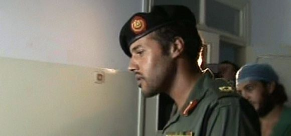 """An image grab taken from footage broadcast by Libyan state TV shows what it said was Khamis Kadhafi, Moamer Kadhafi's youngest son, visiting """"victims of NATO raids"""" at a hospital in an unspecified location on August 9, 2011 just days after rebels battling the regime reported his death, which Tripoli denied at the time. AFP PHOTO/LIBYAN TV"""