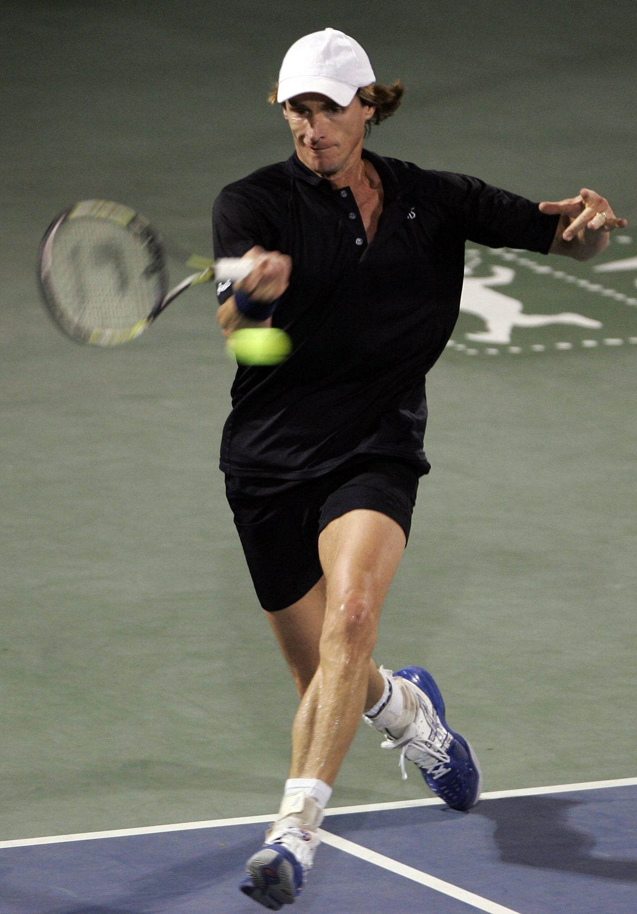 "Dutch tennis legend Paul Haarhuis returns the ball during 'The Legends ""Rock"" Dubai' tennis championship final against US legend Jim Courier in the Gulf emirate of Dubai, 24 November 2007. Haarhuis won the match. Now in its third year, 'The Legends ""Rock"" Dubai' brings together some of the world's most famous and successful tennis players ever to grace the courts for three days of intense action at the Dubai Tennis Stadium. AFP PHOTO/KARIM SAHIB"