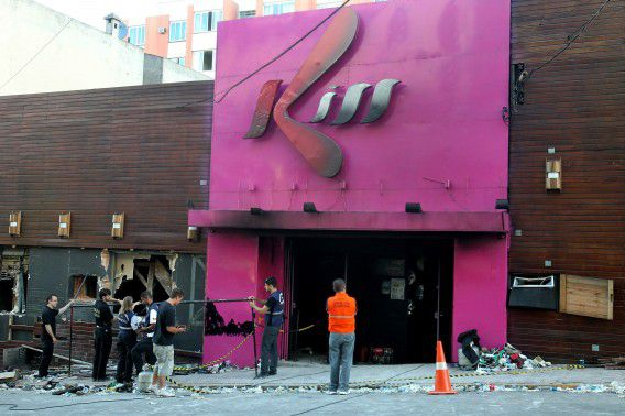investigators inspect the entrance of the Kiss nightclub in Santa Maria city, Rio Grande do Sul state, Brazil, Sunday, Jan. 27, 2013. Flames raced through a crowded nightclub in southern Brazil early Sunday, killing more than 230 people as panicked partygoers gasped for breath in the smoke-filled air, stampeding toward a single exit partially blocked by those already dead. (AP Photo/Nabor Goulart)