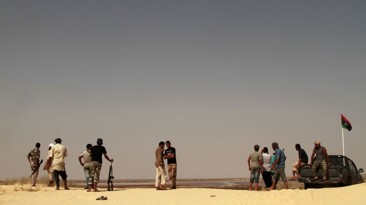 Rebel fighters have positioned several outposts along the Mediterranean coast, some 60 kilometers south of Misrata, Libya, Monday, Sept. 5, 2011. Troops have been patrolling the coastal area to prevent incursions by Gadhafi supporters still present in the towns that separate Misrata from Sirte. (AP Photo/Gaia Anderson)
