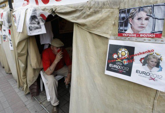 A man sits in a tent for supporters of jailed opposition leader Yulia Tymoshenko in Kiev, May 7, 2012. Tymoshenko was sentenced to seven years in prison last October for abuse of office after a trial the West said was politically motivated. Tymoshenko is in prison in the city of Kharkiv, one of the Euro 2012 venues, and is on hunger strike in protest at what she said was an assault by guards, an allegation denied by the prison administration. REUTERS/Anatolii Stepanov (UKRAINE - Tags: POLITICS)