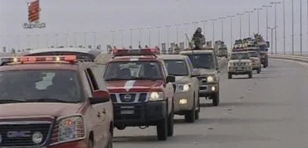 Caption: This screen grab taken from Bahrain TV shows troops arriving in Bahrain from Saudi Arabia on Monday, March 14, 2011. A Saudi-led military force crossed into Bahrain on Monday to prop up the monarchy against widening demonstrations, launching the first cross-border military operation to quell unrest since the Arab world's rebellions began in December. (AP Photo/Bahrain TV via APTN)