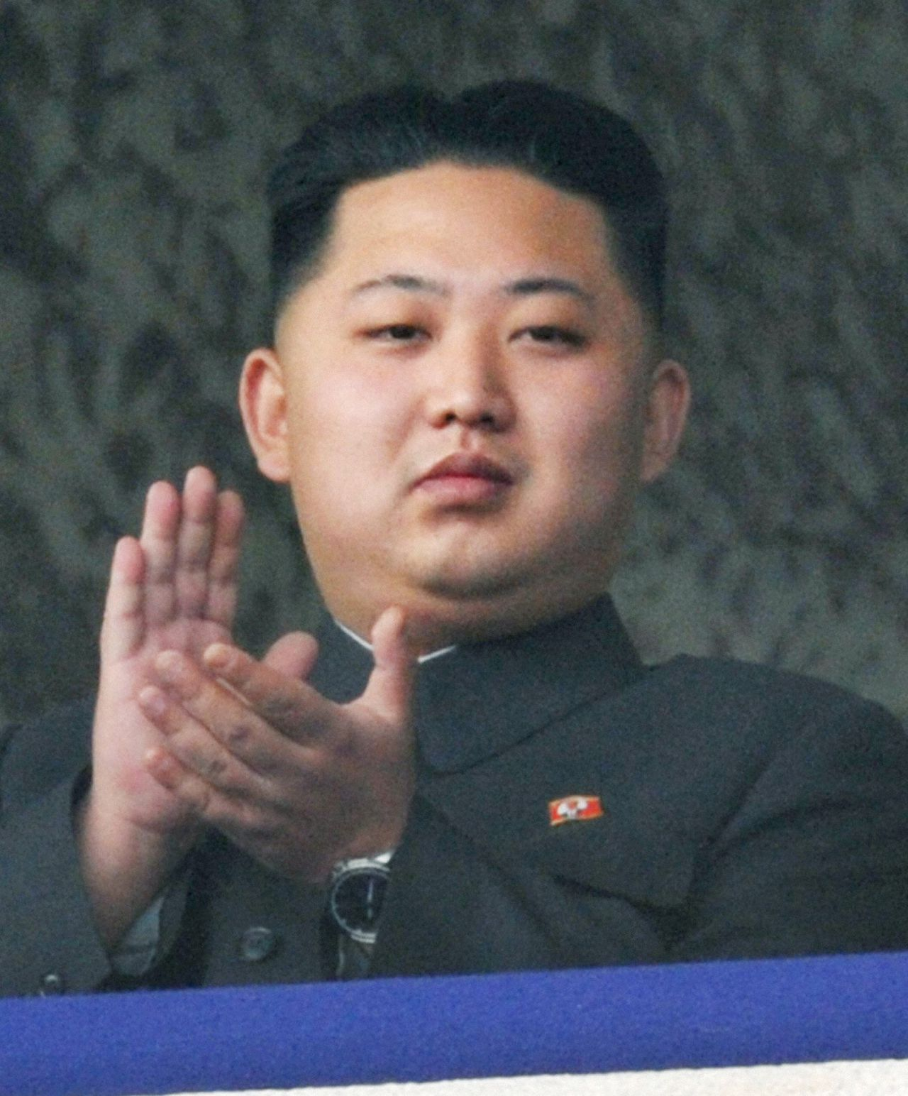 "Kim Jong-un, the youngest son of North Korean leader Kim Jong-il, applauds as he watches a parade to commemorate the 65th anniversary of the founding of the Workers' Party of Korea in Pyongyang in this October 10, 2010 file photo. North Korean leader Kim Jong-il died on a train trip, state television reported on December 19, 2011 sparking immediate concern over who is in control of the reclusive state and its nuclear programme. A tearful announcer dressed in black said the 69-year old had died on December 17, 2011 of physical and mental over-work on his way to give ""field guidance"". REUTERS/Kyodo/Files (NORTH KOREA - Tags: POLITICS TPX IMAGES OF THE DAY ANNIVERSARY OBITUARY) JAPAN OUT. NO COMMERCIAL OR EDITORIAL SALES IN JAPAN. FOR EDITORIAL USE ONLY. NOT FOR SALE FOR MARKETING OR ADVERTISING CAMPAIGNS"