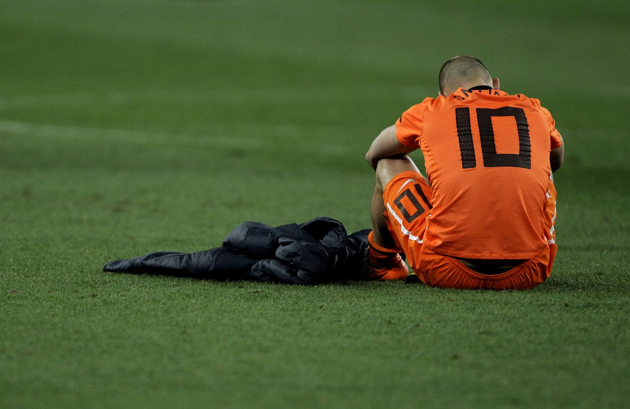 Netherlands' Wesley Sneijder sits on the pitch after the World Cup final soccer match between the Netherlands and Spain at Soccer City in Johannesburg, South Africa, Sunday, July 11, 2010. Spain won 1-0. (AP Photo/Frank Augstein)