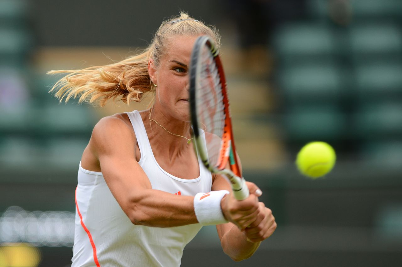 Netherland's Arantxa Rus plays a shot during her second round women's singles match against Australia's Samantha Stosur on day three of the 2012 Wimbledon Championships tennis tournament at the All England Tennis Club in Wimbledon, southwest London, on June 27, 2012. AFP PHOTO / LEON NEAL RESTRICTED TO EDITORIAL USE