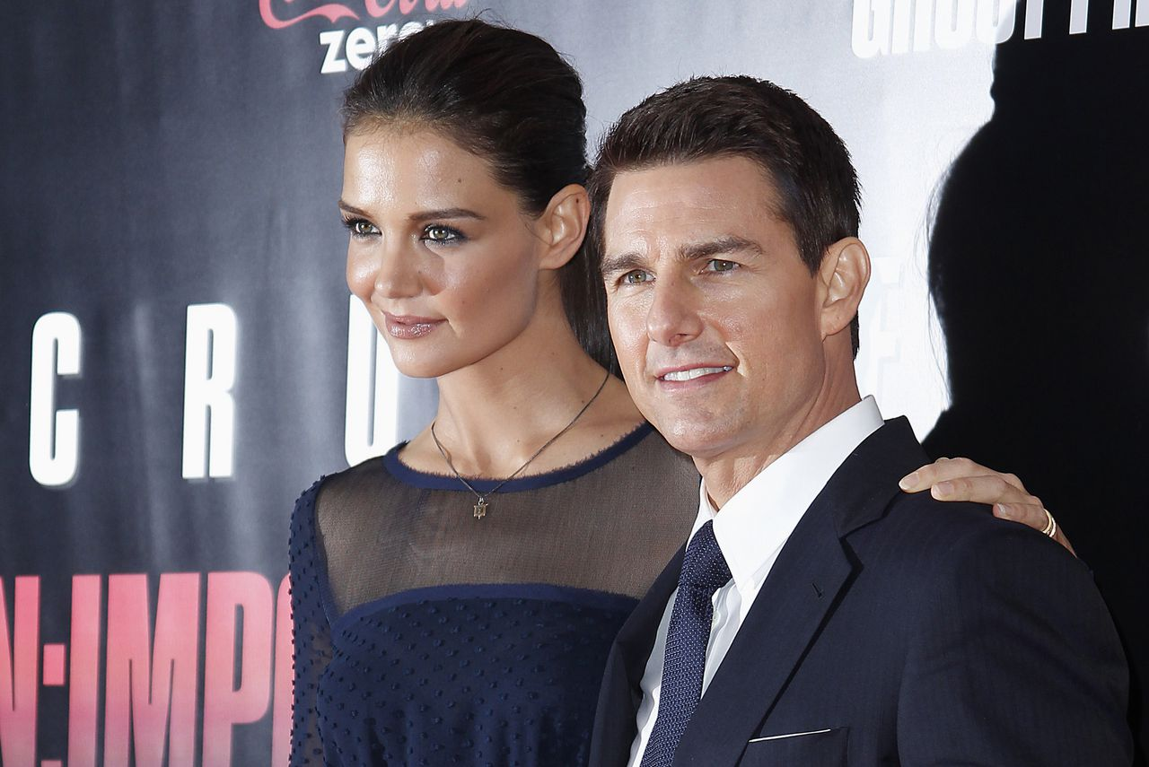 """Cast member Tom Cruise and his wife Katie Holmes arrive for the premiere of the film """"Mission: Impossible - Ghost Protocol"""" in New York in this December 19, 2011 file photo.Hollywood superstar couple Cruise and Holmes are planning to divorce, People magazine reported, citing Holmes' attorney. REUTERS/Carlo Allegri/Files (UNITED STATES - Tags: ENTERTAINMENT)"""