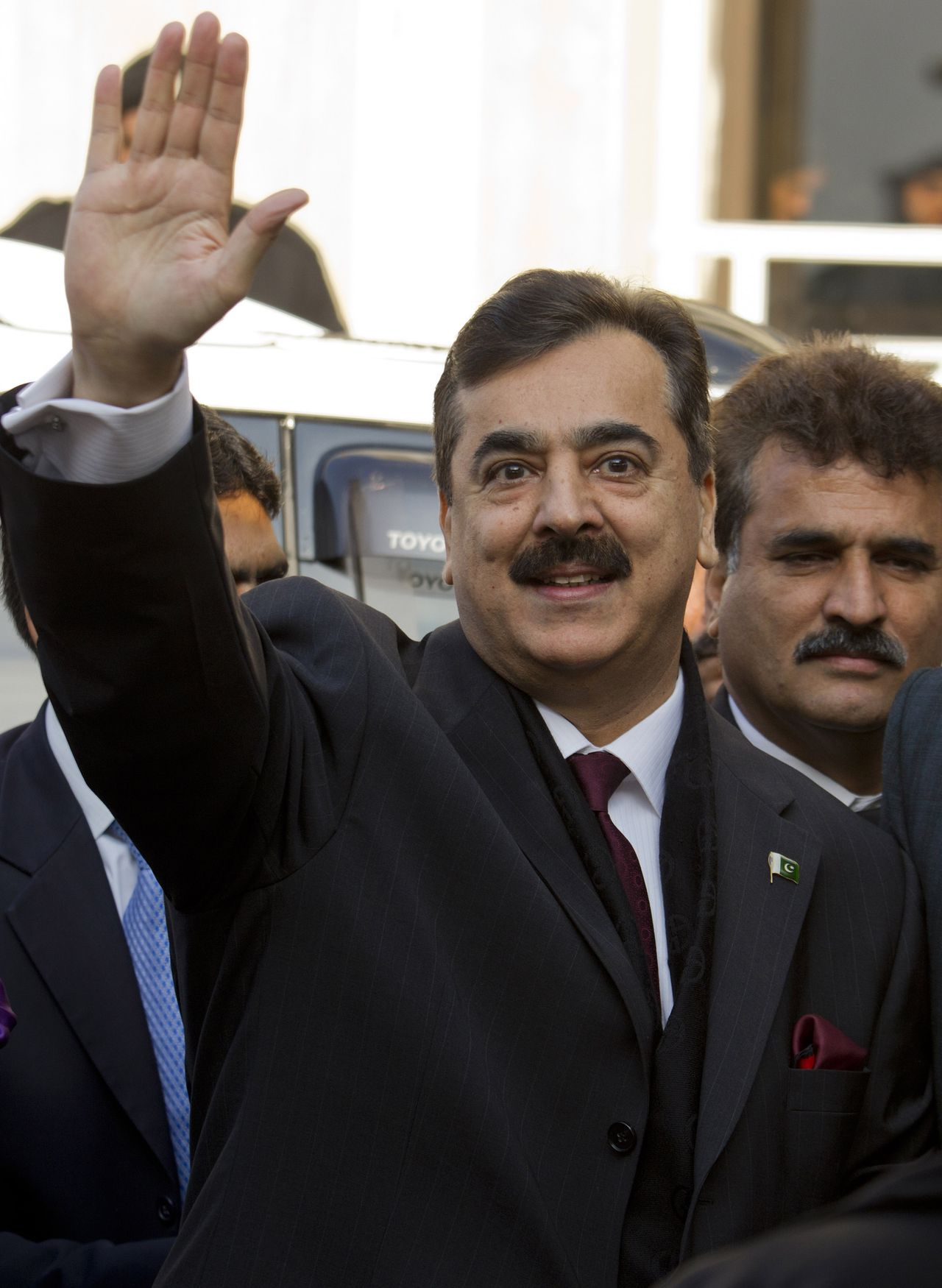 Pakistani Prime Minister Yousuf Raza Gilani waves upon his arrival at the Supreme Court in Islamabad, Pakistan on Thursday, Jan. 19, 2012. Pakistan's prime minister has made a rare appearance before the Supreme Court in attempt to avoid being held in contempt for refusing to reopen an old corruption case against the president. (AP Photo.B.K.Bangash)