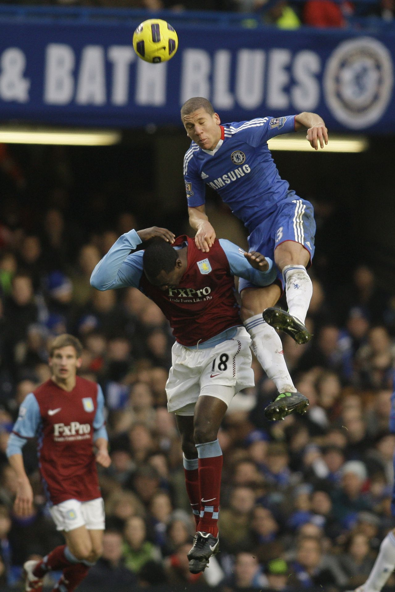 Chelsea's Jeffery Bruma, right, competes with Aston Villa's Emile Heskey during their English Premier League soccer match at Stamford Bridge, London, Sunday, Jan. 2, 2011. (AP Photo/Sang Tan) NO INTERNET/MOBILE USAGE WITHOUT FOOTBALL ASSOCIATION PREMIER LEAGUE (FAPL) LICENCE - CALL +44 (0)20 7864 9121 or EMAIL info@football-dataco.com FOR DETAILS