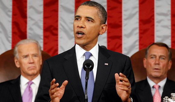 Caption: President Barack Obama delivers a speech to a joint session of Congress at the Capitol in Washington, Thursday, Sept. 8, 2011. Watching are Vice President Joe Biden and House Speaker John Boehner. (AP Photo/Kevin Lamarque, POOL)
