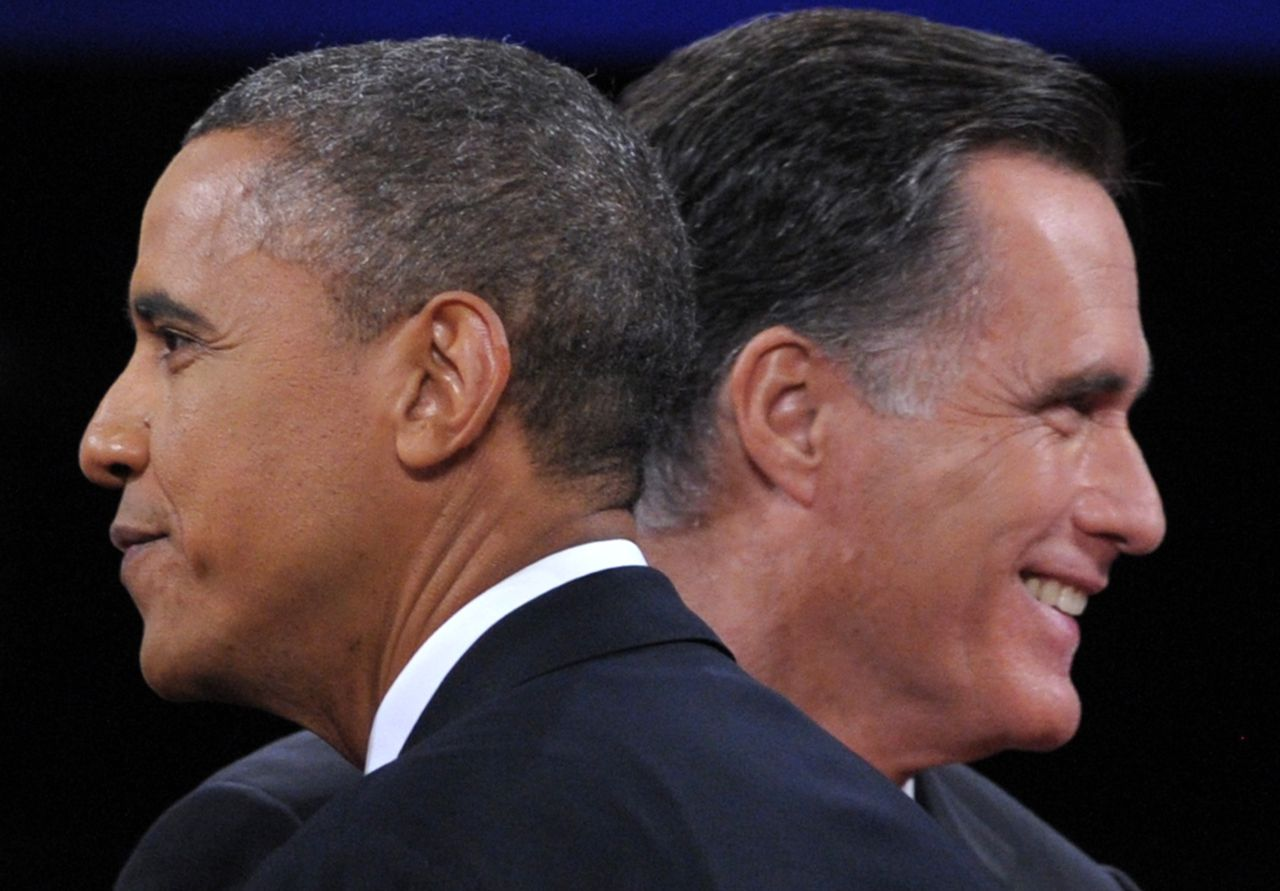 TOPSHOTS US President Barack Obama (L) greets Republican presidential candidate Mitt Romney (R) following the third and final presidential debate at Lynn University in Boca Raton, Florida, October 22, 2012. The showdown focusing on foreign policy is being held in the crucial toss-up state of Florida just 15 days before the election and promises to be among the most watched 90 minutes of the entire 2012 campaign. AFP PHOTO / Saul LOEB