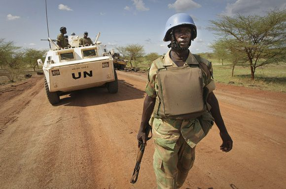 A soldier from Zambia serving with the international peacekeeping operation patrols on the ground in the region of Abyei, central Sudan, in this handout picture released by the United Nations Mission in Sudan (UNMIS) May 30, 2011. United Nations military observers (UNMOs) and patrols have been steadily expanding their reach throughout the Abyei area in a concerted drive to increase visible presence of UN peacekeepers and to step up patrol and observation activities following the occupation by the northern Sudan Armed Forces (SAF) in Abyei. The expansion also includes a now permanent presence of UNMOs in temporary operating bases in both Diffra and Agok, north and south of Abyei town. REUTERS/Stuart Price/UNMIS/Handout (SUDAN - Tags: MILITARY POLITICS) FOR EDITORIAL USE ONLY. NOT FOR SALE FOR MARKETING OR ADVERTISING CAMPAIGNS. THIS IMAGE HAS BEEN SUPPLIED BY A THIRD PARTY. IT IS DISTRIBUTED, EXACTLY AS RECEIVED BY REUTERS, AS A SERVICE TO CLIENTS