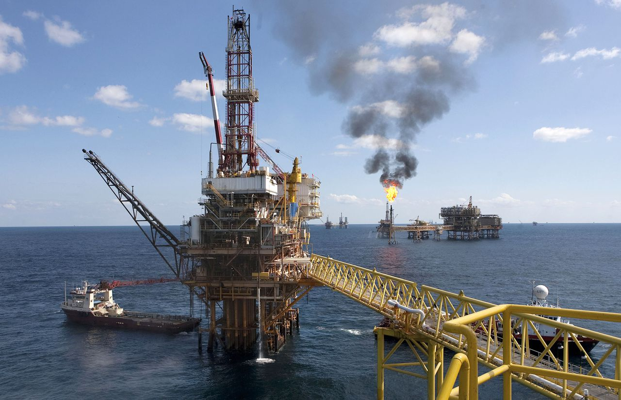 """A Petroleos Mexicanos offshore platform produces oil from the Ku-Maloob-Zaap field in the Gulf of Mexico 65 miles northeast of Ciudad del Carmen, Mexico, on Thursday, Oct. 7, 2010. Ku-Maloob-Zaap, Mexico's largest oil project, will keep producing about 850,000 barrels a day """"for the next two or three years,"""" the company said in May. Pemex, as the state-owned company is known, is Latin America's largest oil producer. Photographer: Susana Gonzalez/Bloomberg"""