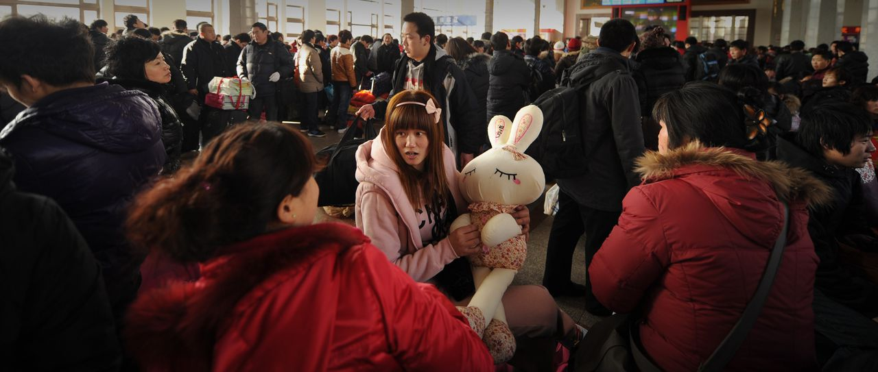 Passengers wait for trains during the Lunar New Year travel peak in Beijing railway station on January 28, 2011. Getting home for Chinese New Year used to mean squeezing into rundown trains that creak their way through the countryside but this year, many are opting for the comfort and ever-expanding network of China's high-speed trains, even if it means paying on average more than three times more -- sparking concern the not-so-wealthy are losing out. AFP PHOTO/Peter PARKS
