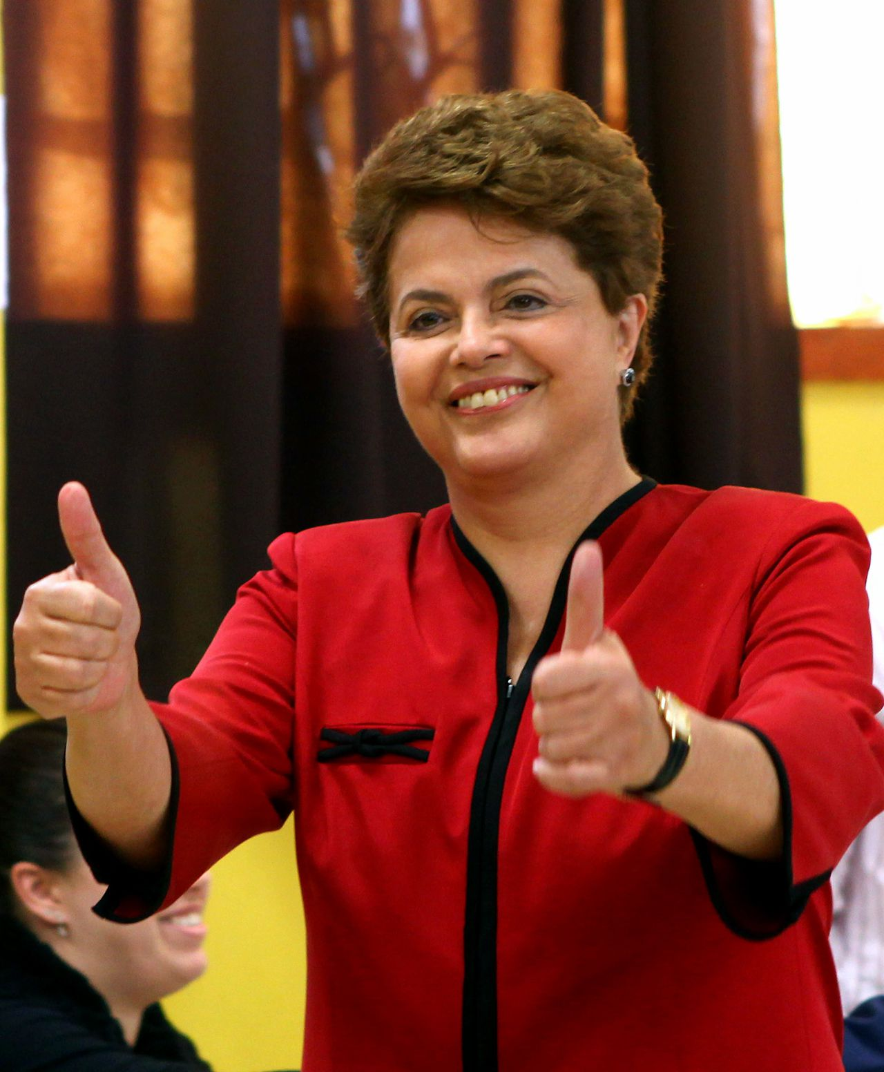 FILES - TO GO WITH AFP STORY - Brazilian presidential candidate for the ruling Workers Party (PT) Dilma Rousseff, gives her thumbs up after voting at a polling station in Porto Alegre, state of Rio Grande do Sul, Brazil, on October 31, 2010. Roussef, the first female President of Brazil, will have to impose a personal profile to the head of the country. AFP PHOTO/Jefferson BERNARDES