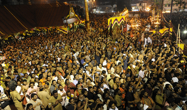 Hindu devotees pray at the Sabarimala temple during the Maravilakku festival marking the final of a two-month pilgrimage to the Lord Ayyappa temple in Kerala, south India on January 14, 2011. At least 64 people died and scores were injured today in a stampede at a religious festival in southern India triggered by a vehicle crashing into a crowd, officials said. AFP PHOTO/STR