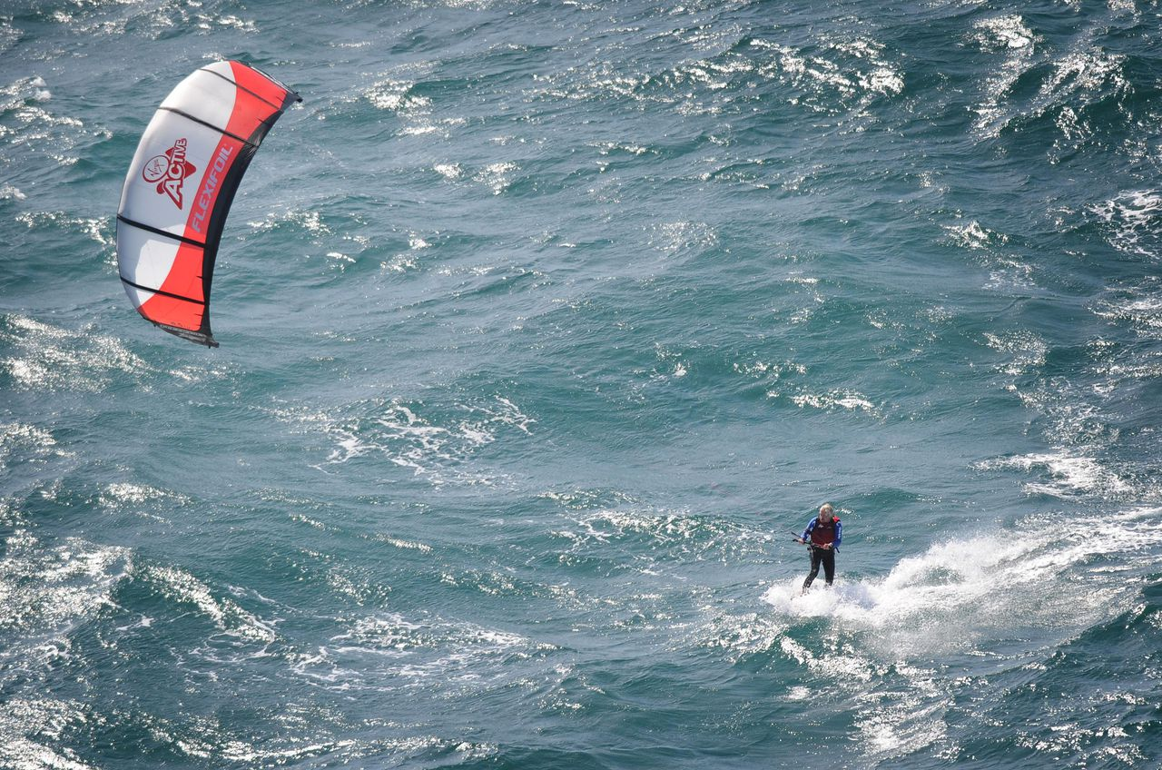Sir Richard Branson 61, kite-surfs to northern France, from Dymchurch in Kent, entering the record books as the oldest person to kite-surf the English Channel - on his second attempt in 24 hours.