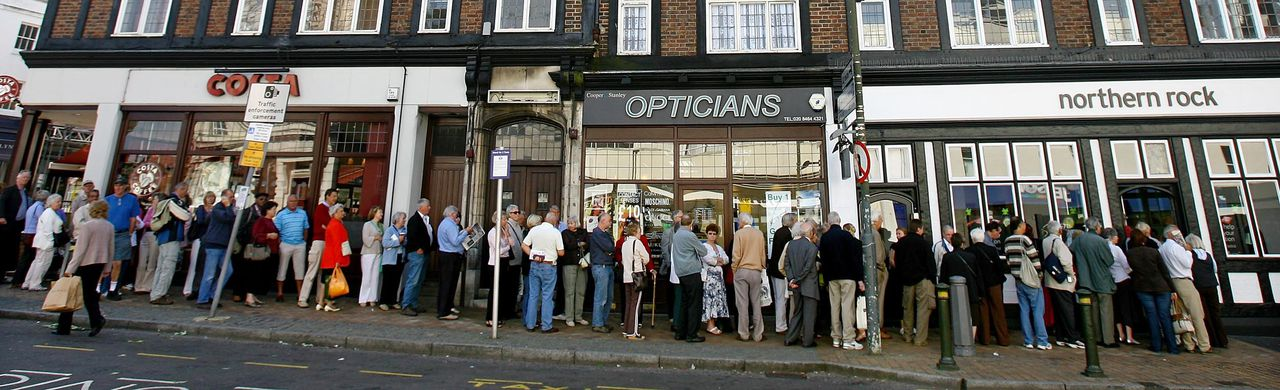 """Customers queue to enter a Northern Rock branch in Bromley, in south-east London, 14 September 2007. The Bank of England has stepped in to provide emergency financial support to Britain's fifth-largest mortgage lender Northern Rock, the latest institution to fall victim to market turmoil, officials confirmed Friday. In a statement, the Bank of England's Treasury and Financial Services Authority said: """"The Chancellor of the Exchequer has today authorised the Bank of England to provide a liquidity support facility to Northern Rock"""". The move comes after Northern Rock struggled to raise money to finance its lending amid money market volatility in the last few months linked to the sub-prime mortgage sector in the United States. AFP PHOTO/BEN STANSALL"""