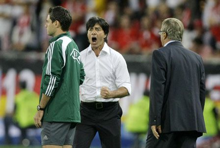 ** FILE ** In this June 16, 2008 file photo Germany's head coach Joachim Loew, center, and Austria's head coach Josef Hickersberger, right, argue with the match's fourth official Damir Skomina from Slovenia, left, during the group B match between Austria and Germany in Vienna, Austria, at the Euro 2008 European Soccer Championships in Austria and Switzerland. Loew was banned from the touchline for Thursday's European Championship quarterfinal match against Portugal. Loew and Austria coach Josef Hickersberger were both given one-game suspensions Wednesday, June 18, 2008 the agency APA said, after they were banished to the stands by the referee after they appeared to bicker with the fourth official during Germany's 1-0 group win on Monday. (AP Photo/Frank Augstein)