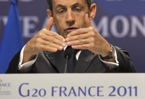 France's President Nicolas Sarkozy speaks during a news conference at the G20 Summit of major world economies in Cannes November 3, 2011. Sarkozy called for Greece to remain in the Euro Zone, but said they must want to stay as well. REUTERS/Philippe Wojazer (FRANCE - Tags: POLITICS BUSINESS)