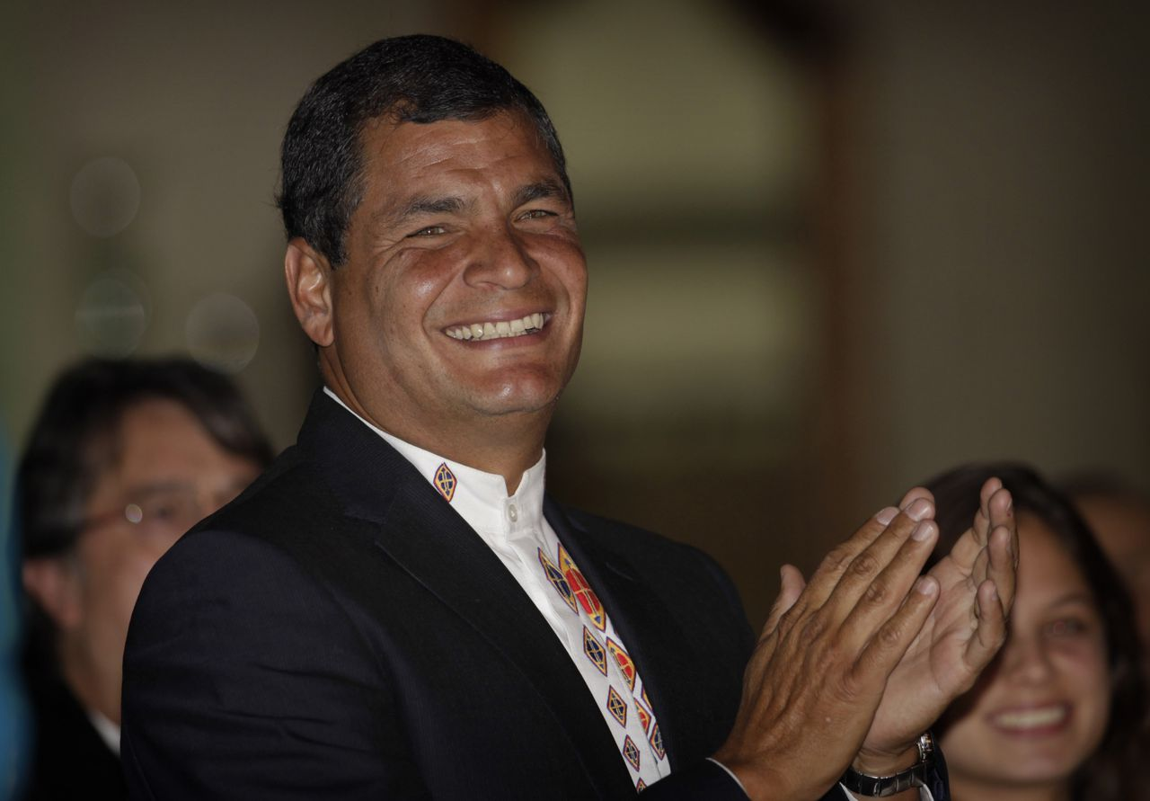 Ecuador's President Rafael Correa celebrates his election victory in Quito, Ecuador, Sunday, Feb.17, 2013. Correa coasted to a second re-election on Sunday winning 56.7 percent of the vote against 24 percent for his closest challenger, former Banco de Guayaquil chief Guillermo Lasso, with 36 percent of the vote counted.(AP Photo/Dolores Ochoa)