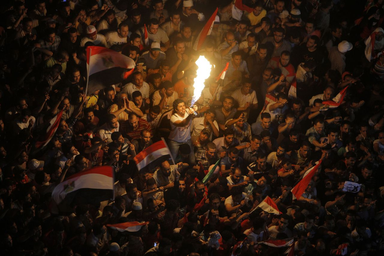 Egyptians celebrate the victory of Mohammed Morsi, in the presidential elections, in Tahrir Square, Cairo, Egypt, Sunday, June 24, 2012. Morsi was declared Egypt's first Islamist president on Sunday after the freest elections in the country's history, narrowly defeating Hosni Mubarak's last Prime Minister Ahmed Shafiq in a race that raised political tensions in Egypt to a fever pitch. (AP Photo/Amr Nabil)