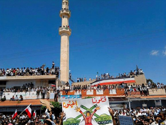 Demonstrators protesting against Syria's President Bashar al-Assad gather in Deraa
