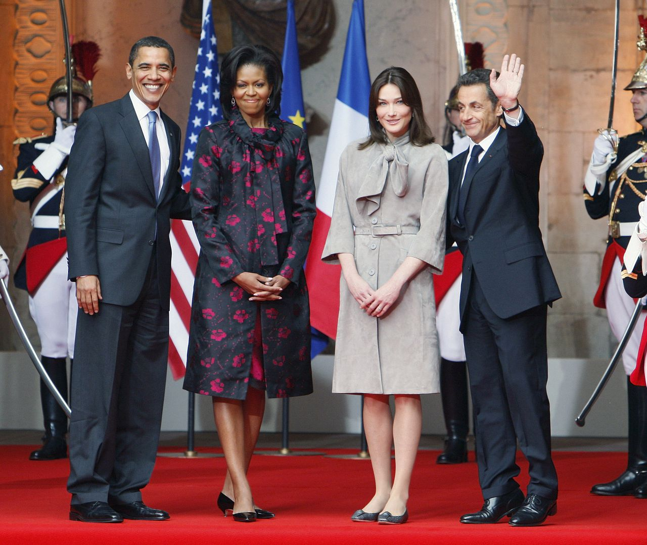 FILE - This April 3, 2009 file photo, shows President Barack Obama and first lady Michelle Obama greeted by France's President Nicolas Sarkozy and wife Carla Bruni-Sarkozy at Palais Rohan in Strasbourg. French President Nicolas Sarkozy announced Wednesday that he will seek a second term despite years of low popularity ratings, pledging to boost its lagging economy and protect France's way of life. (AP Photo/Charles Dharapak/File)