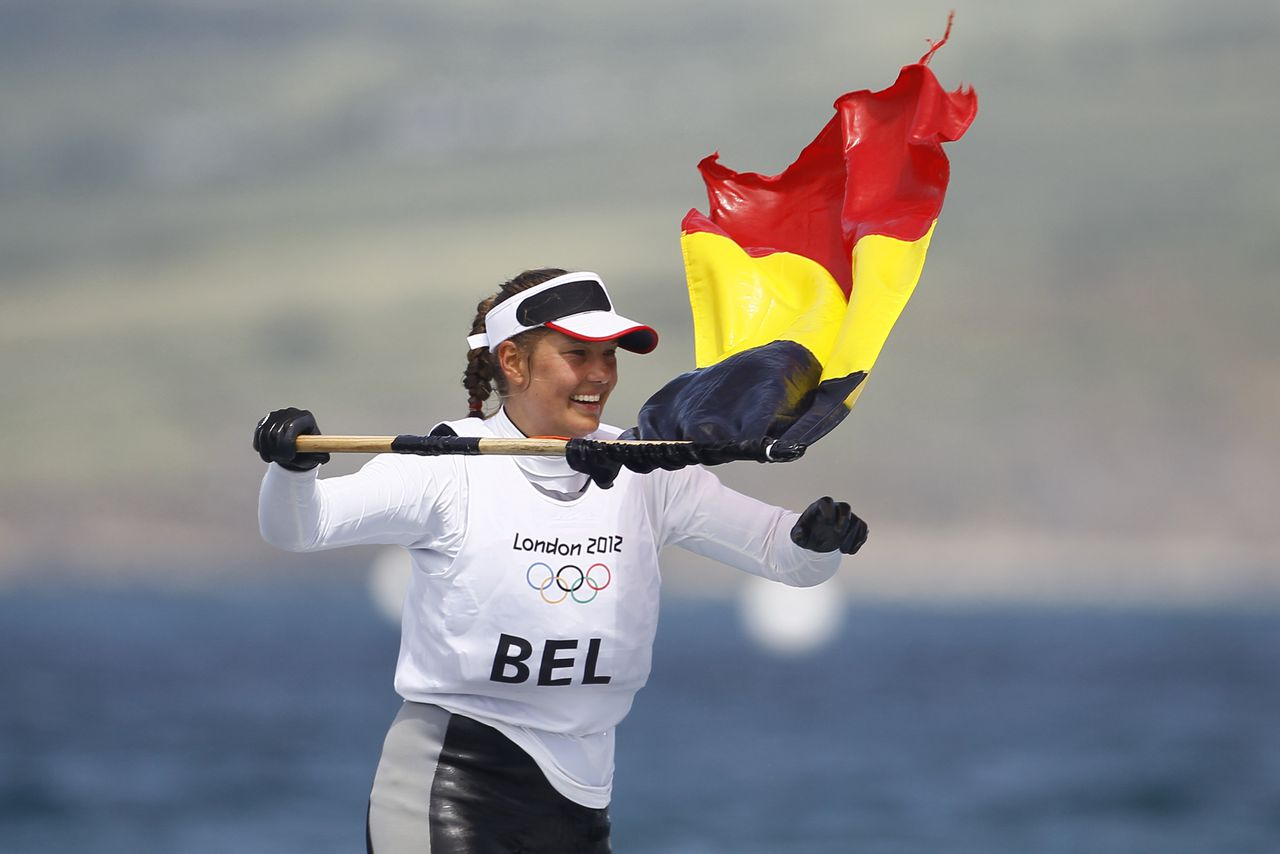 Evi Van Acker of Belgium celebrates her bronze medal during the Laser radial sailing medal race at the London 2012 Summer Olympics, Monday, Aug. 6, 2012, in Weymouth and Portland, England. (AP Photo/Francois Mori)