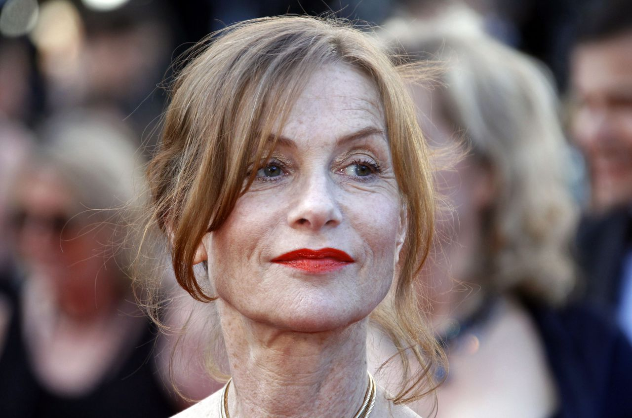 """Actress Isabelle Huppert arrives on the red carpet for the screening of the film """"The Tree of Life"""" in competition at the 64th Cannes Film Festival in Cannes May 16, 2011. REUTERS/Jean-Paul Pelissier (FRANCE - Tags: ENTERTAINMENT HEADSHOT)"""