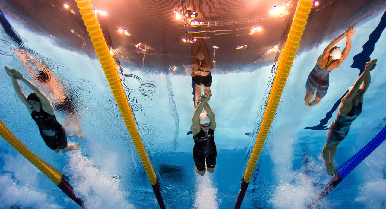 PICTURE TAKEN WITH UNDERWATER CAMERA (FromL) Netherland's Inge Dekker, Australia's Alicia Coutts and US' Missy Franklin compete in the women's 4 x 100m freestyle relay final swimming event at the London 2012 Olympic Games on July 28, 2012 in London. AFP PHOTO / FRANCOIS XAVIER MARIT