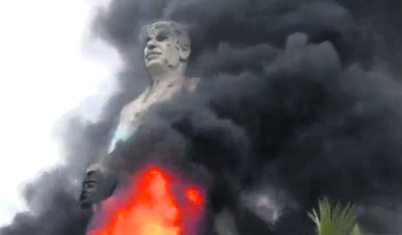 In this image taken from video obtained from Ugarit News, which has been authenticated based on its contents and other AP reporting, a statue of Hafez Assad, father of Syrian President Bashar Assad, burns after being set on fire by rebel fighters inside the grounds of the General Company of the Euphrates Dam in Al-Raqqa, Syria, Monday, Feb. 11, 2013. Syrian rebels captured the country's largest dam on Monday after days of intense clashes, giving them control over water and electricity supplies for much of the country in a major blow to President Bashar Assad's regime. (AP Photo/Ugarit News via AP video)