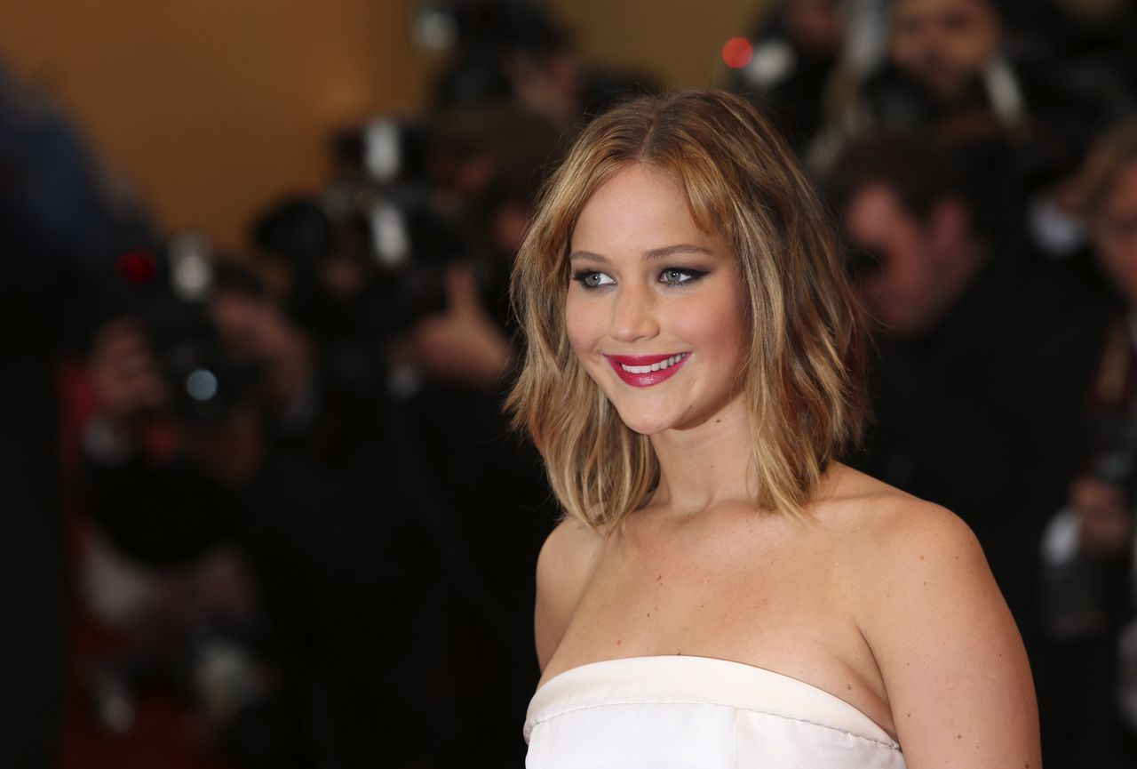 Actress Jennifer Lawrence poses for photographers as she arrives on the red carpet for the screening of the film Jimmy P. Psychotherapy of a Plains Indian at the 66th international film festival, in Cannes, southern France, Saturday, May 18, 2013. (Photo by Joel Ryan/Invision/AP)