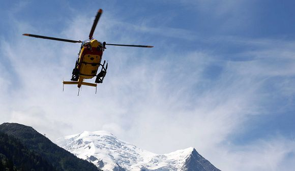 Caption: A rescue worker helicopter returning from the avalanche site, lands in Chamonix, French Alps, Thursday, July, 12, 2012. An avalanche in the French Alps swept six European climbers to their deaths on a slope leading to Mont Blanc, and left at least nine others injured and several climbers unaccounted for, authorities said. Two climbers were rescued and emergency crews are searching for the missing. A group of 28 climbers from Switzerland, Germany, Spain, France, Denmark and Serbia are believed to be in the expedition caught in the avalanche that was about 4,000 meters (13,1000 feet) high on the north face of Mont Maudit, part of the Mont Blanc range. (AP Photo)