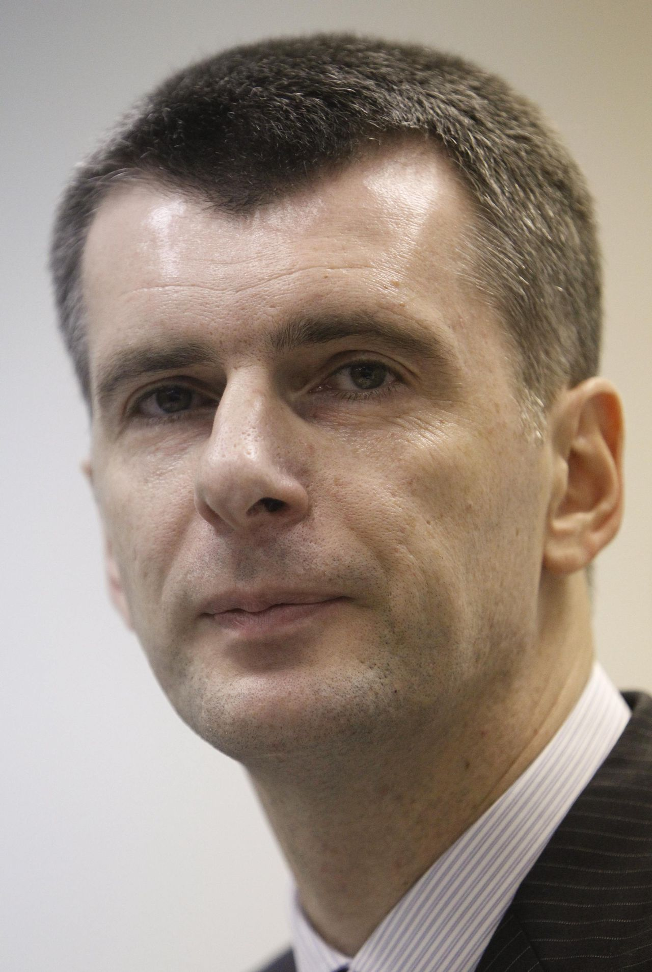 Russian billionaire Mikhail Prokhorov looks on during a news conference in Moscow December 12, 2011. Prokhorov announced on Monday his intention to run for president during the March 2012 election. REUTERS/Sergei Karpukhin (RUSSIA - Tags: POLITICS ELECTIONS HEADSHOT)