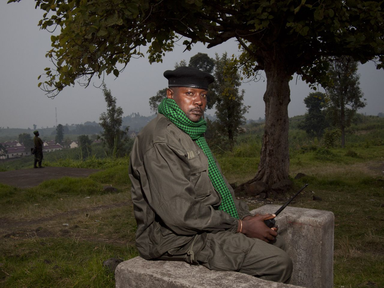 An M23 rebel soldier poses at a FARDC base taken yesterday in Rumangabo on July 9, 2012. Congolese mutineers on July 9, 2012 pulled out of the key eastern town of Rutshuru, near the borders with Uganda and Rwanda, a day after seizing it. The M23 movement -- a group of former Tutsi rebels who had been integrated in the regular army in 2009 -- has been battling Democratic Republic of Congo troops since May. In recent days, the rebels had seized several towns in the troubled Nord Kivu province, including Rutshuru, which lies some 20 kilometres (12 miles) from the Ugandan border, half-way between Lake Edward and Lake Kivu. AFP PHOTO/Michele Sibiloni