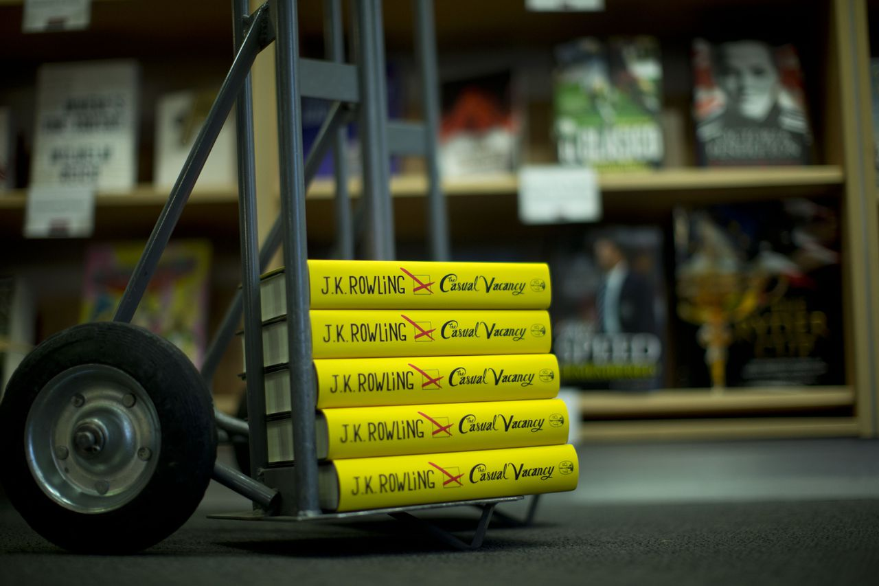 """Copies of the """"The Casual Vacancy"""" by author J.K. Rowling stand on a trolley ready to go on the shelves at a book store in London, Thursday, Sept. 27, 2012. British bookshops are opening their doors early as Harry Potter author J.K. Rowling launches her long anticipated first book for adults. Publishers have tried to keep details of the book under wraps ahead of its launch Thursday, but """"The Casual Vacancy"""" has gotten early buzz about references to sex and drugs that might be a tad mature for the youngest """"Potter"""" fans. (AP Photo/Matt Dunham)"""