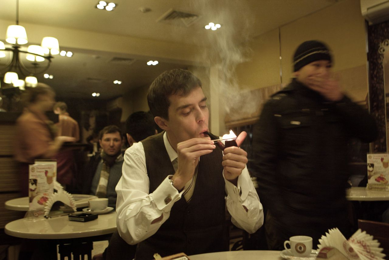 Mr. Roman Dobrochotov at a bar with his pipe always. Headline:Russian middle class. Foreign Desk. Article by Michel Crielaars. Photo by Oleg Klimov