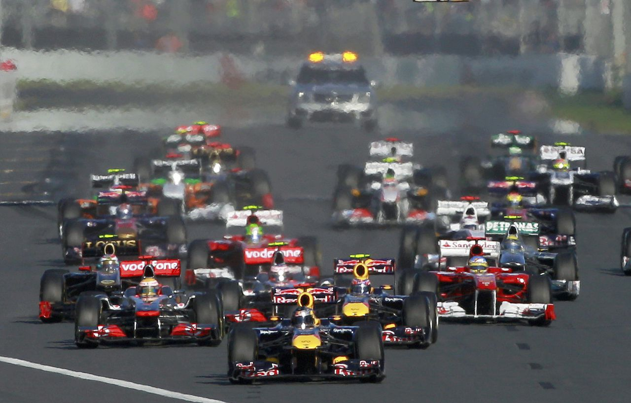 Red Bull Formula One driver Sebastian Vettel of Germany leads the pack at the start of the Australian F1 Grand Prix at the Albert Park circuit in Melbourne March 27, 2011. REUTERS/Mark Horsburgh (AUSTRALIA - Tags: SPORT MOTOR RACING IMAGE OF THE DAY)
