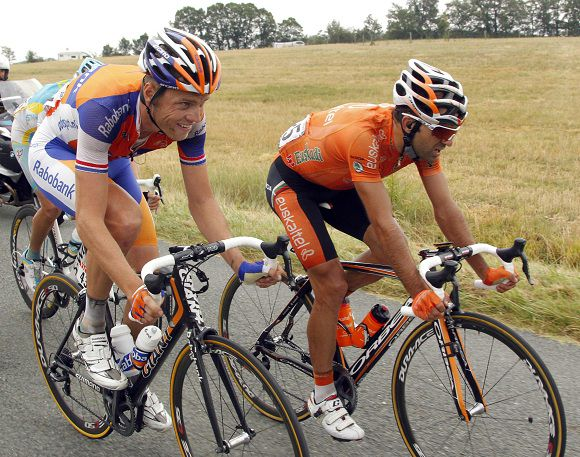 Rabobank rider Lars Boom (L) of the Netherlands rides next to Eskatel Euskadi rider Ruben Perez Moreno of Spain during a break away in the eleventh stage of the Tour de France 2011 cycling race from Blaye Les Mines to Lavaur July 13, 2011. HTC highroad rider Mark Cavendish of Britain won the stage while Europcar rider Thomas Voeckler of France retained the yellow jersey. REUTERS/Pascal Rossignol (FRANCE - Tags: SPORT CYCLING)