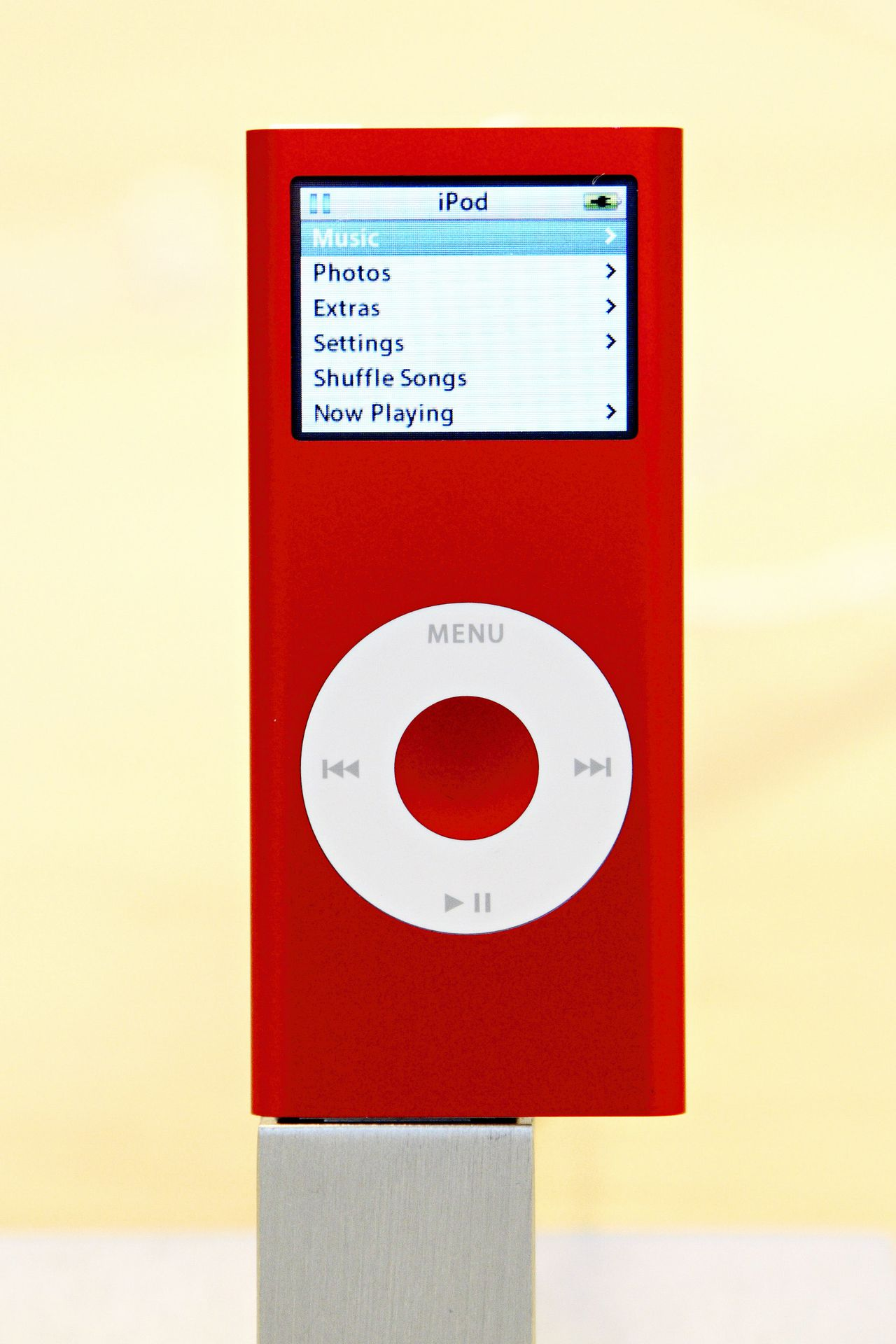 The new red iPod nano on display at the Fifth Avenue Apple store in New York City on Friday, October 13, 2006. Apple announced a new red iPod nano, created by U2 lead singer Bono to help in the fight against AIDS in Africa. Photographer: Adam Rountree/Bloomberg News.