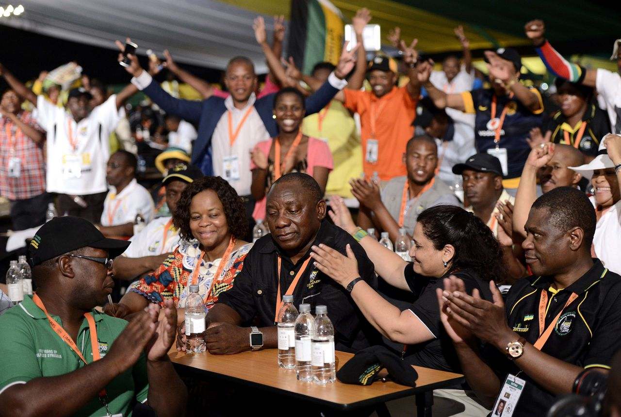Newly-elected deputy president of the African National Congress (ANC) Cyril Ramaphosa (C) is congratulated by delegates during the 53rd National Conference of the ANC on December 18, 2012 in Bloemfontein. Some 4,500 ANC delegates were gathered to nominate candidates to fill the party's top six positions, with embattled President Jacob Zuma facing a leadership challenge from his deputy president Kgalema Motlanthe. Zuma scored a thumping victory in an ANC leadership contest on December 18, opening the way for him to lead Africa's largest economy until 2019. AFP PHOTO / STEPHANE DE SAKUTIN