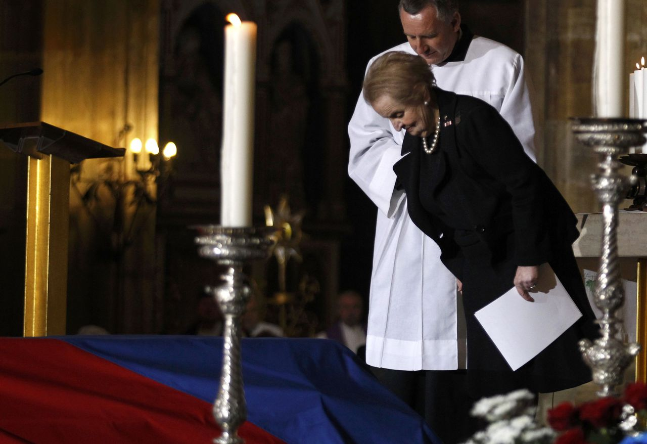 Former U.S. Secretary of State Madeleine Albright pays her respects in front of the coffin of late former President Vaclav Havel during the funeral ceremony inside Prague Castle's St. Vitus Cathedral December 23, 2011. Heads of states and government officials from around the world, and ordinary Czechs bid farewell to Havel. REUTERS/Stoyan Nenov (CZECH REPUBLIC - Tags: POLITICS OBITUARY)