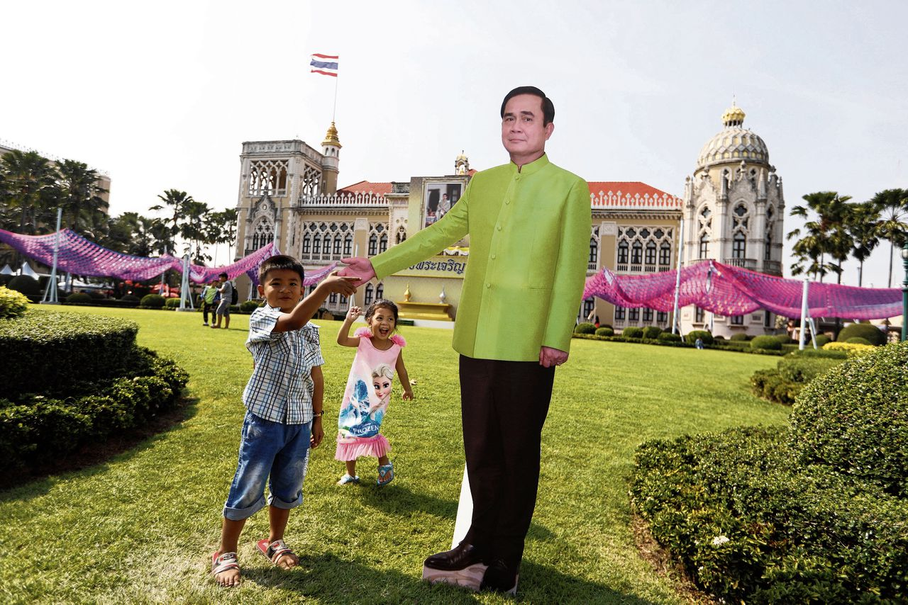 Children play next to a cardboard cutout of Thailand's Prime Minister Prayuth Chan-ocha during the Children's Day celebration at Government House in Bangkok, Thailand, January 13, 2018. REUTERS/Jorge Silva NO RESALES. NO ARCHIVES.